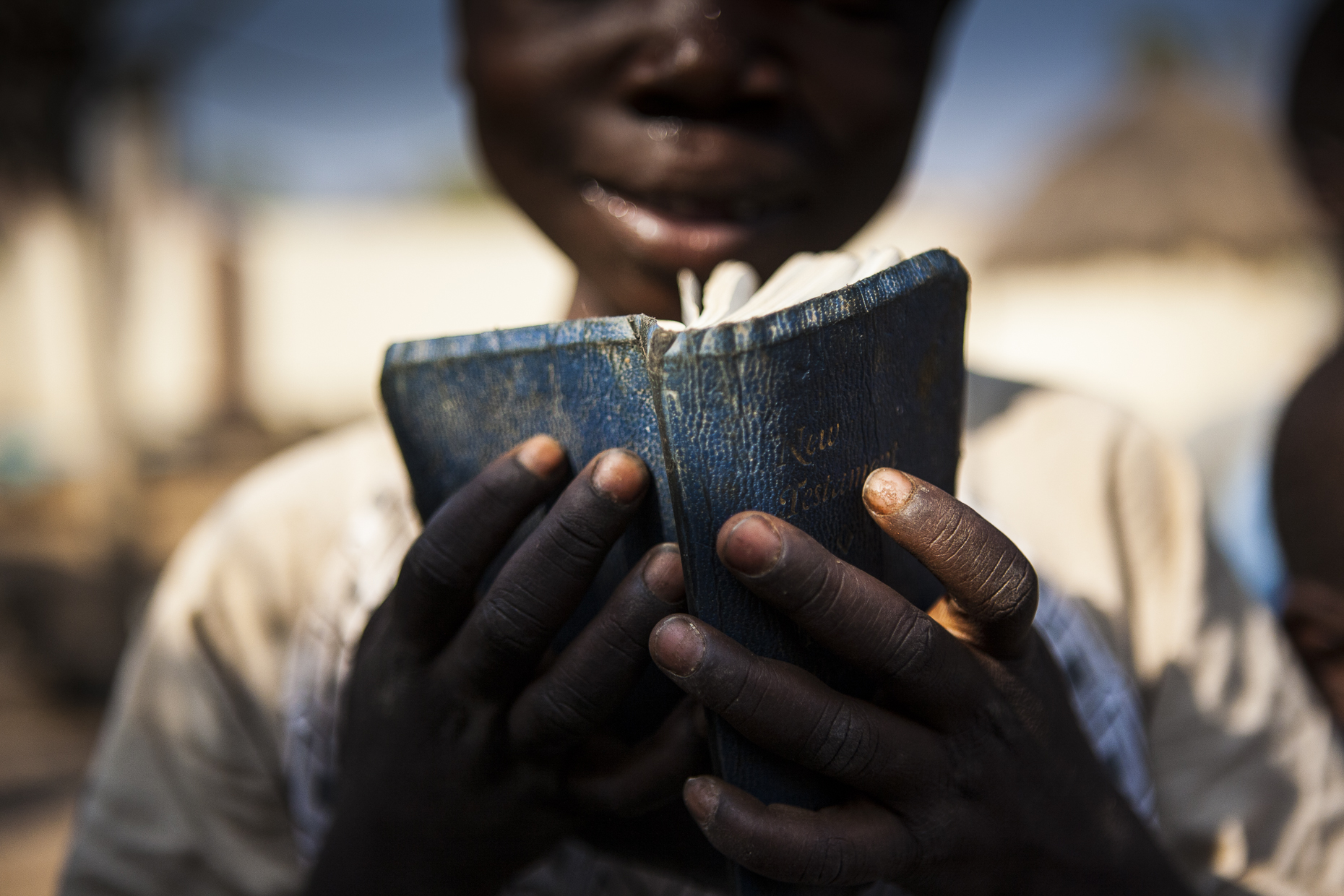 A child reads the bible, Nigeria