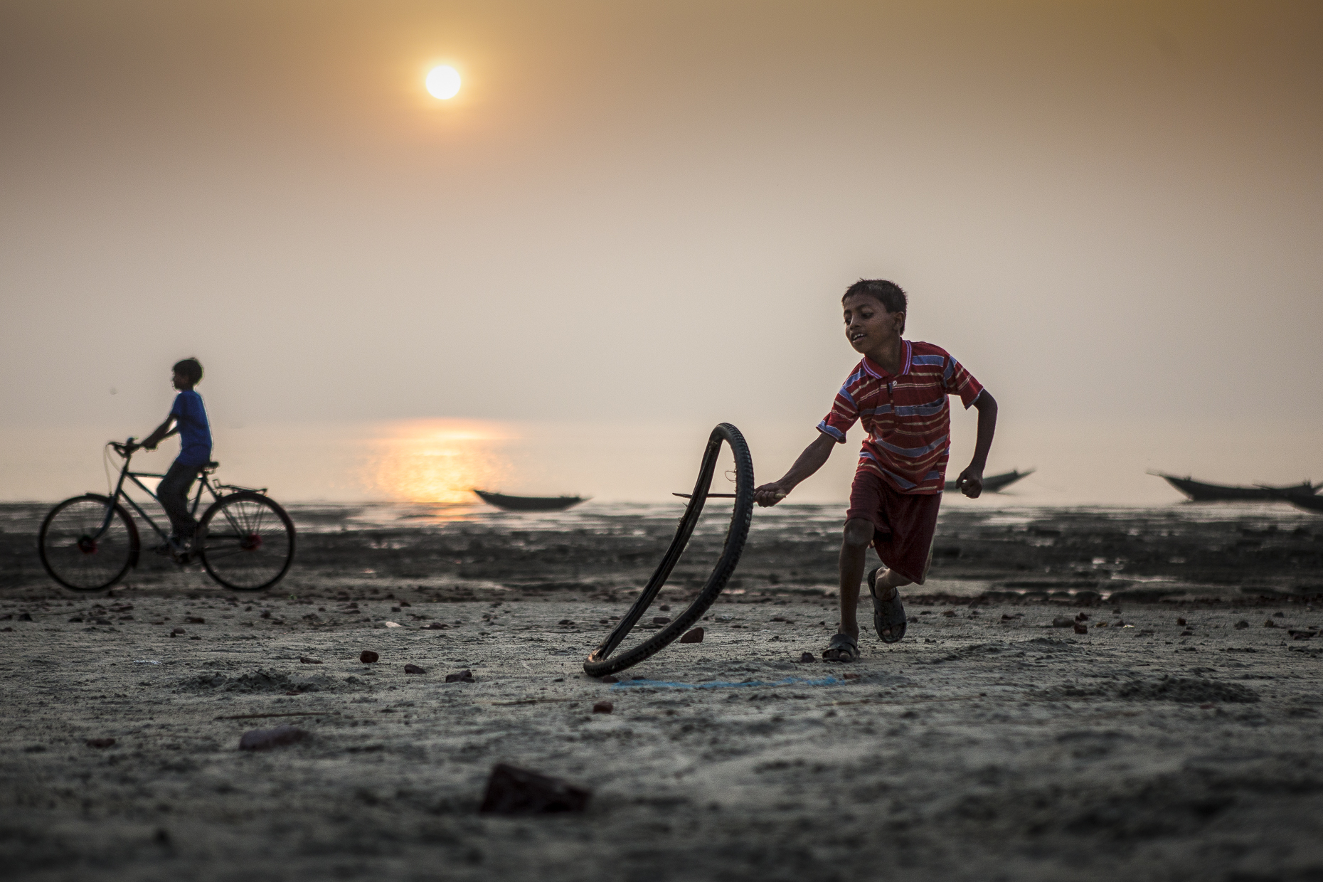 Children playing on beach, Bangladesh